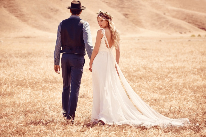 A long maxi gown makes for the perfect bohemian bridal look