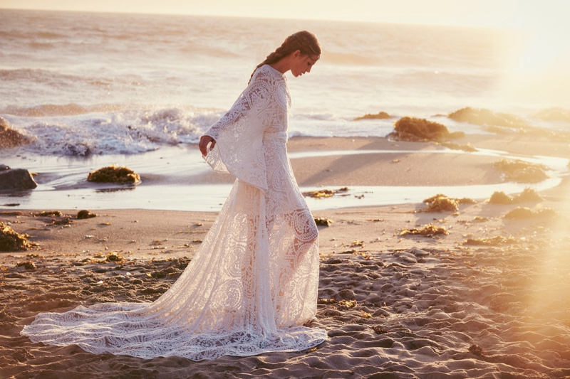 A white lace gown is ideal for a beach wedding