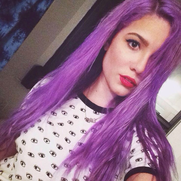 Halsey wears a long purple hairstyle with a red lipstick shade