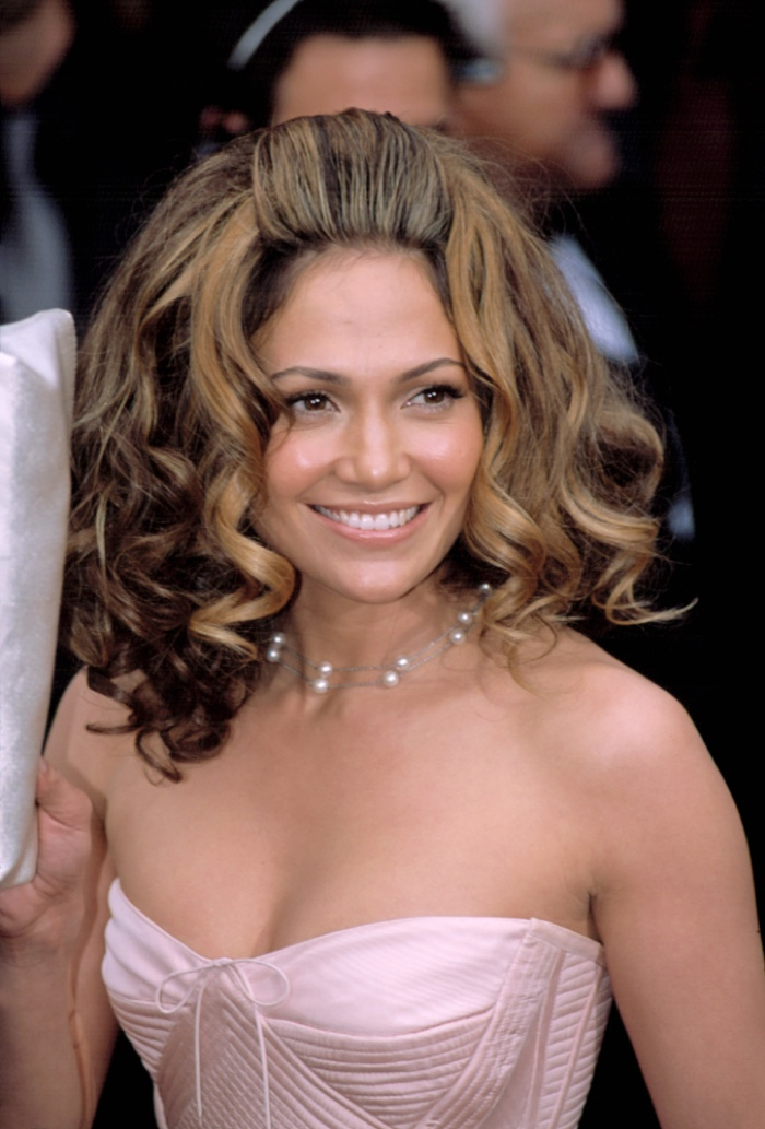 Large and flirty curls were Jennifer Lopez's hairstyle of choice in 2002. Photo: Everett Collection / Shutterstock.com