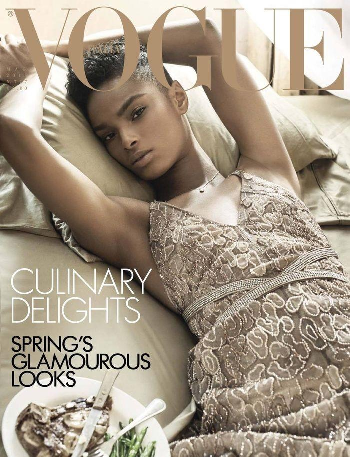 Kayla Scott lounges on the May 2015 cover of Vogue Italia