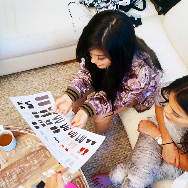 Kendall + Kylie Jenner look over their Topshop collaboration