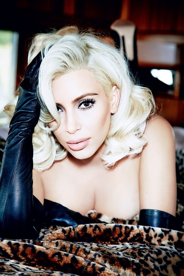 Kim wears her hair in platinum blonde curls for the photo shoot