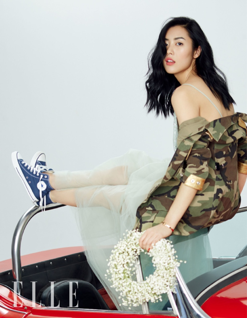 Liu brings rebellious style to her blue dress with a camouflage jacket and converse shoes