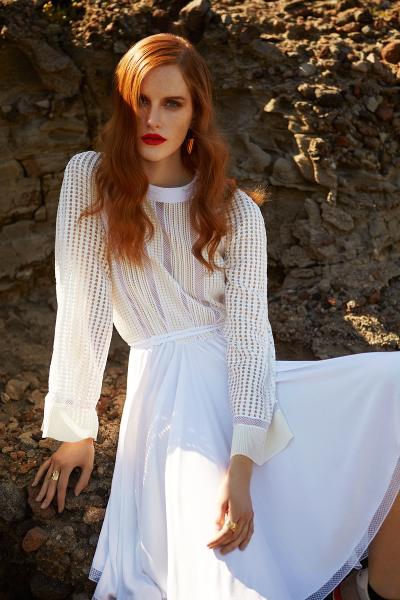 Magdalena wears a white dress from Louis Vuitton