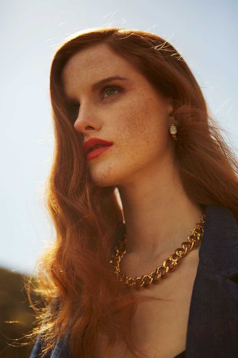 In a closeup beauty shot, Magdalena stuns with a gold necklace and earrings