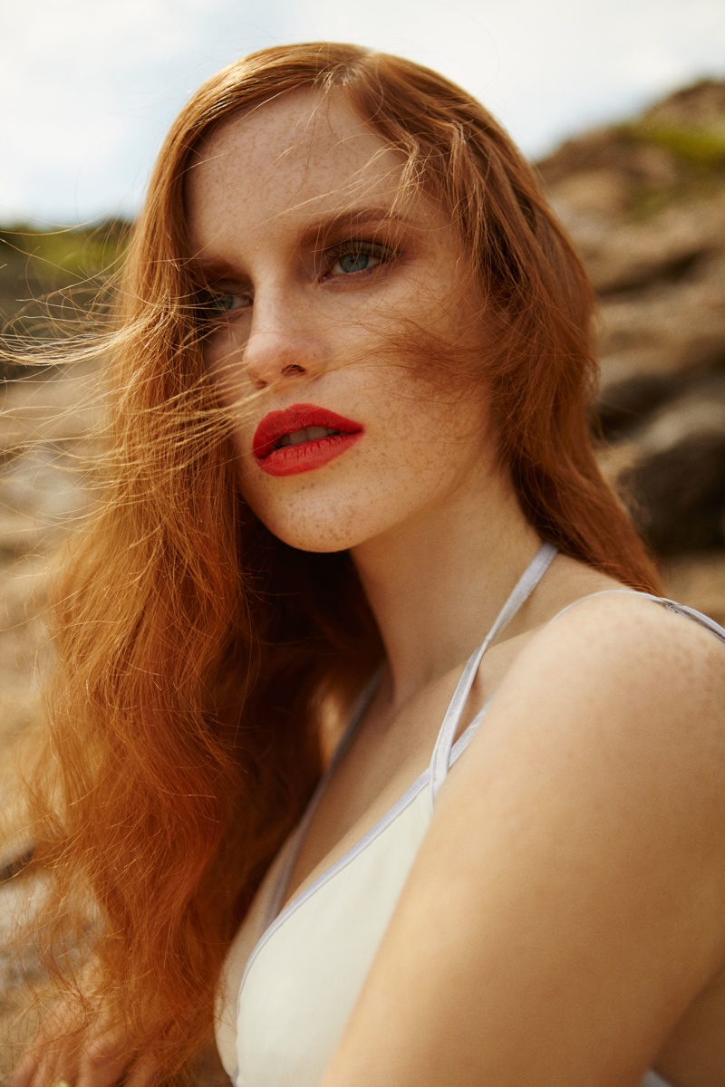 The redhead model shows off her freckles in this image