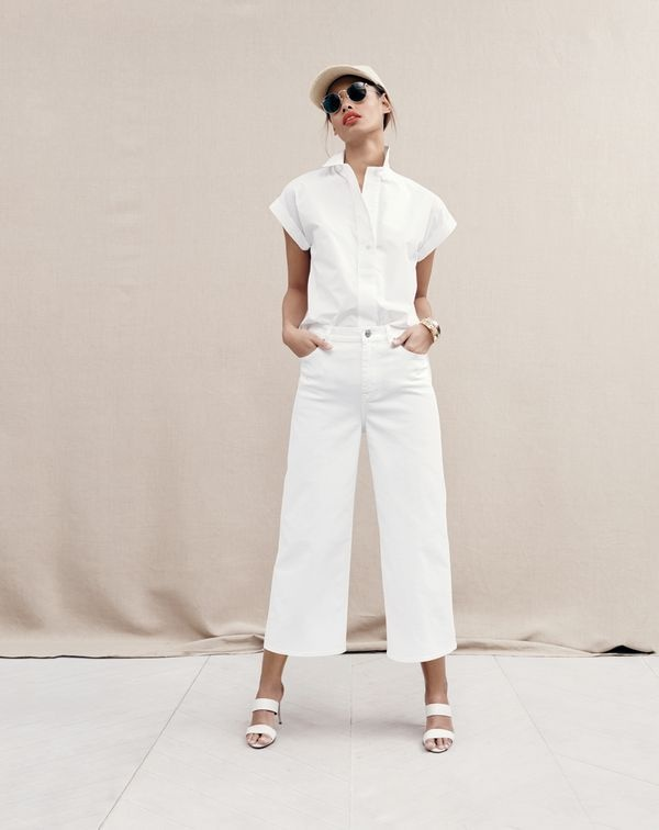 Malaika sports a white top with matching pants and white sandals