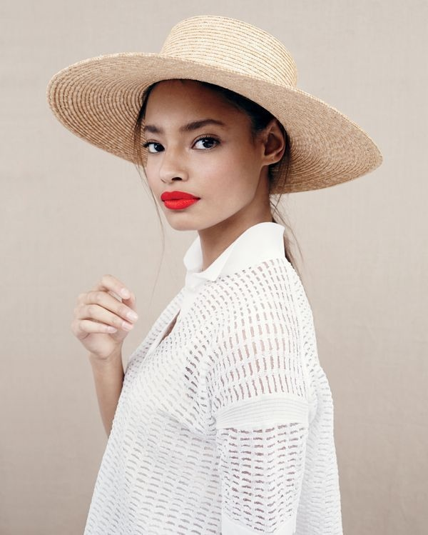 The British model sports a straw hat, perfect for a day out on the beach