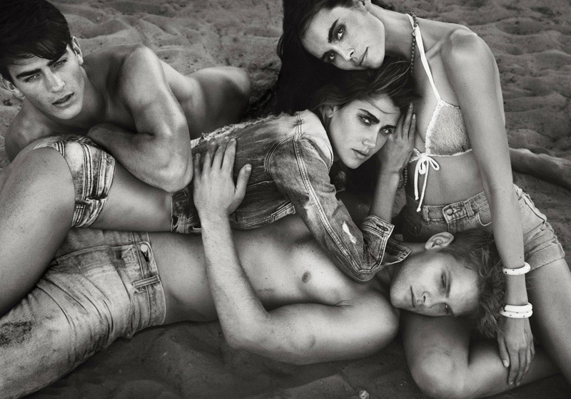 Clad in denim, models strike a sexy pose in the sand