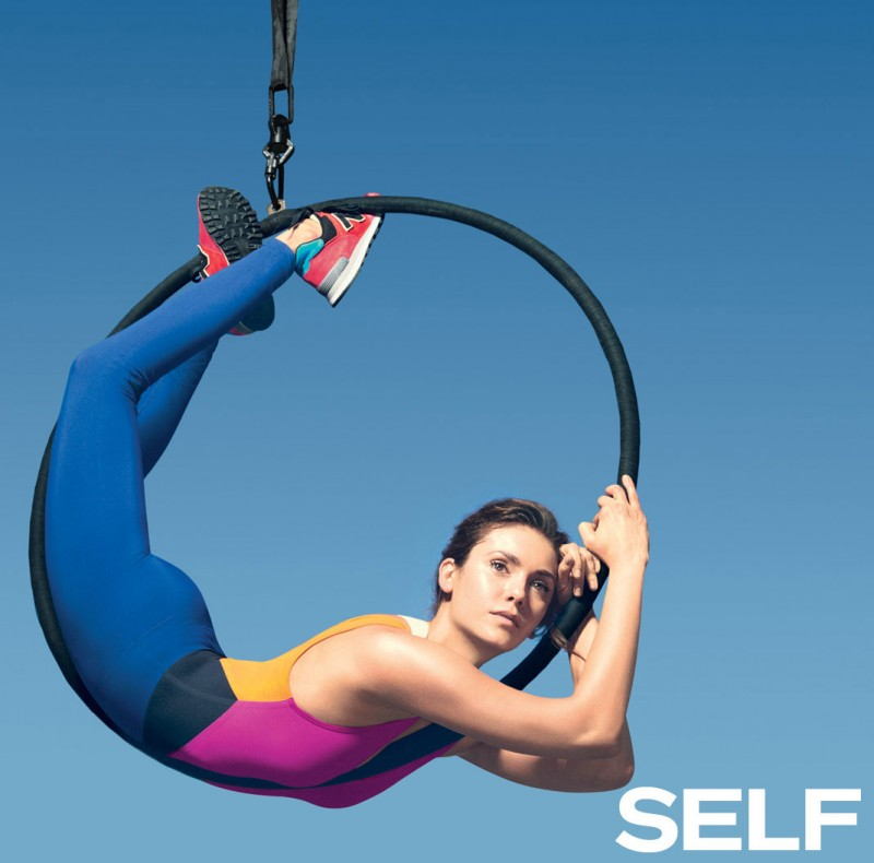 Nina Dobrev is a model of fitness as she poses inside a ring.