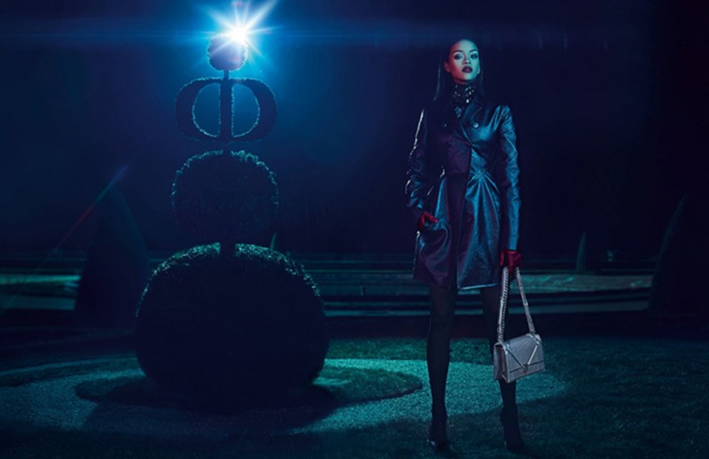 Rihanna poses in the garden, wearing a tailored Dior coat.