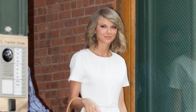 While out and about in New York, Taylor Swift flaunted her long legs in a white Rachel Zoe romper. The star paired the look with a Michael Kors 'Casey' satchel and blue pumps. Photo: StarTraks Photo