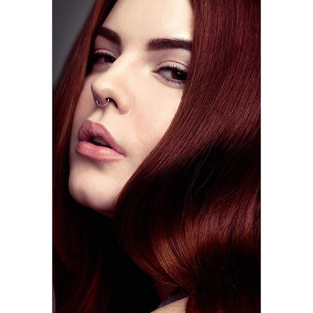 Tess is known for her red hair and starting the hashtag #effyourbeautystandards
