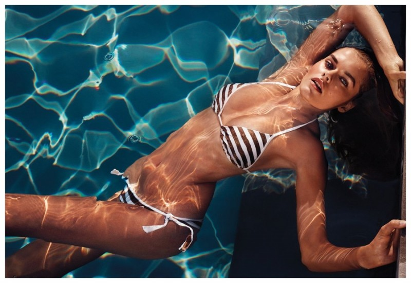 Solveig Mork has a nautical moment in a striped swimsuit.