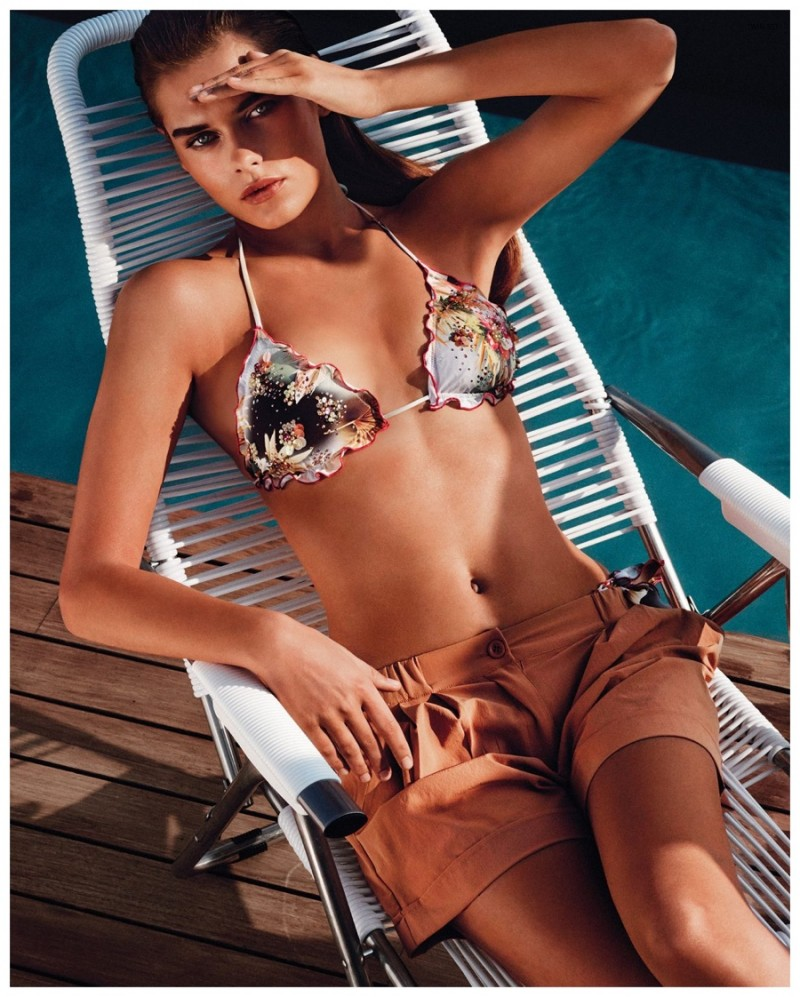 Solveig Mork rocks a cute summer outfit consisting of shorts and a bikini top.