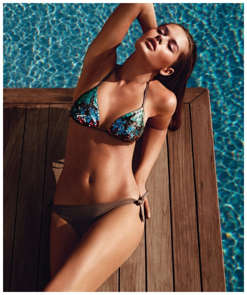 Solveig Mork mixes and matches for an easy poolside swimsuit look.