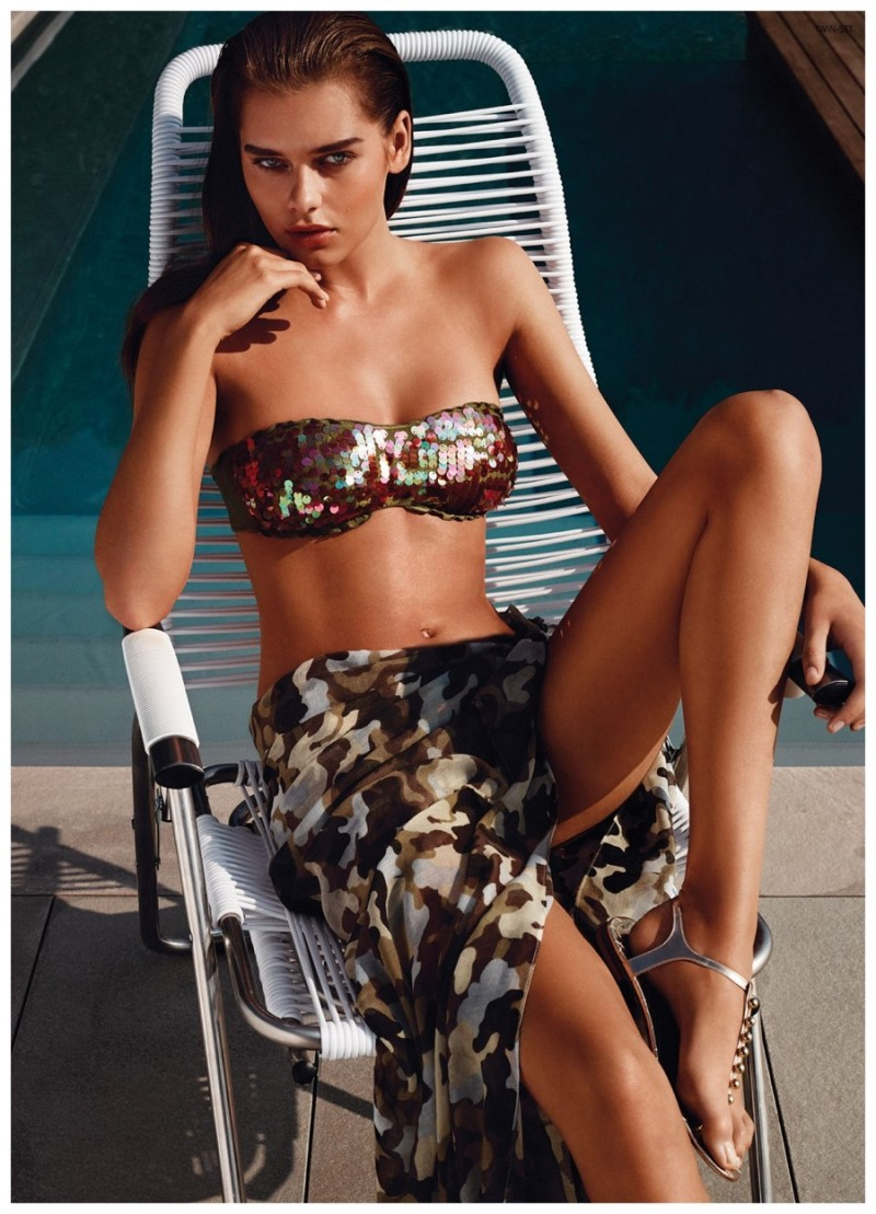 Solveig Mork lounges in a sexy band bikini top with a beach skirt.