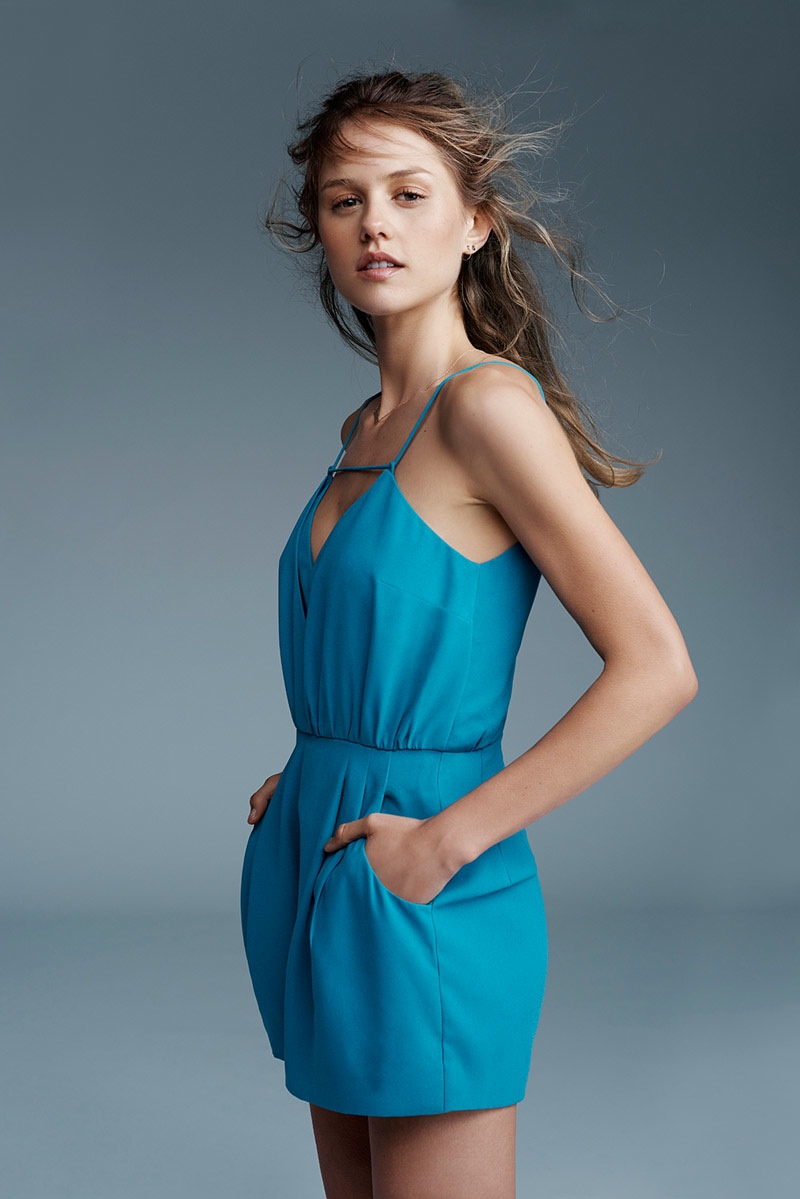 This blue romper with pockets is on trend