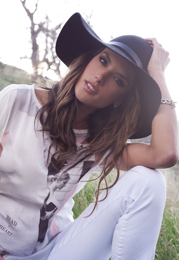 Alessandra wears a wide-brimmed hat and casual tee
