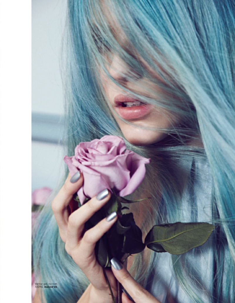 Klaudia takes on an icy blue hairstyle for this image