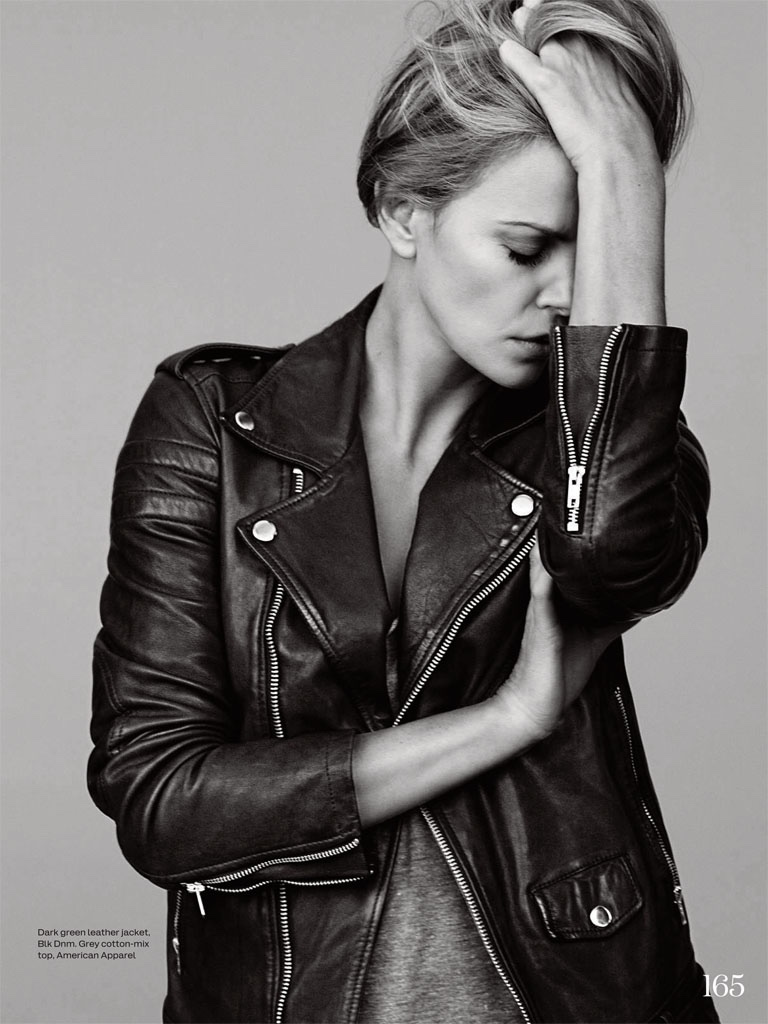 Charlize wears a leather jacket