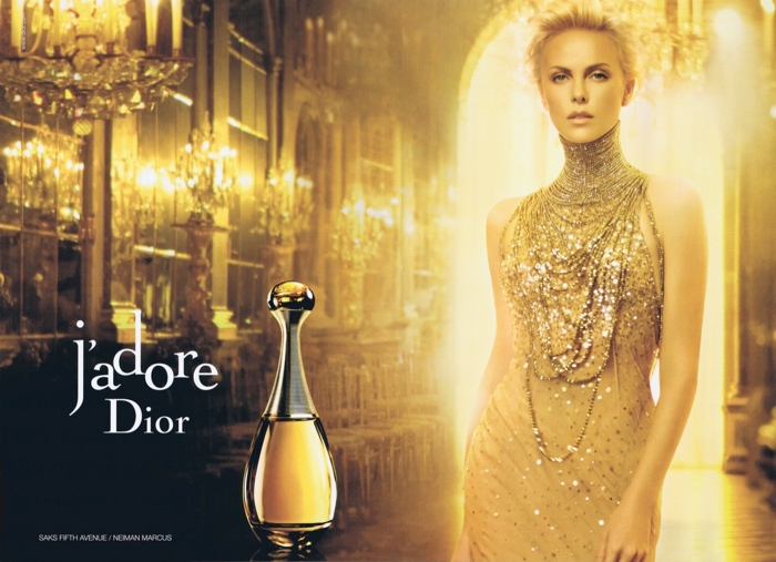 The advertisements often feature the actress dipped in gold. Photo: J'adore Dior campaign from 2012 with Charlize Theron.