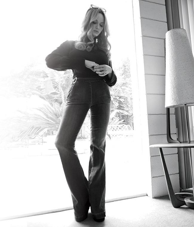 Christina Hendricks wears 1970s inspired fashions for the photo shoot