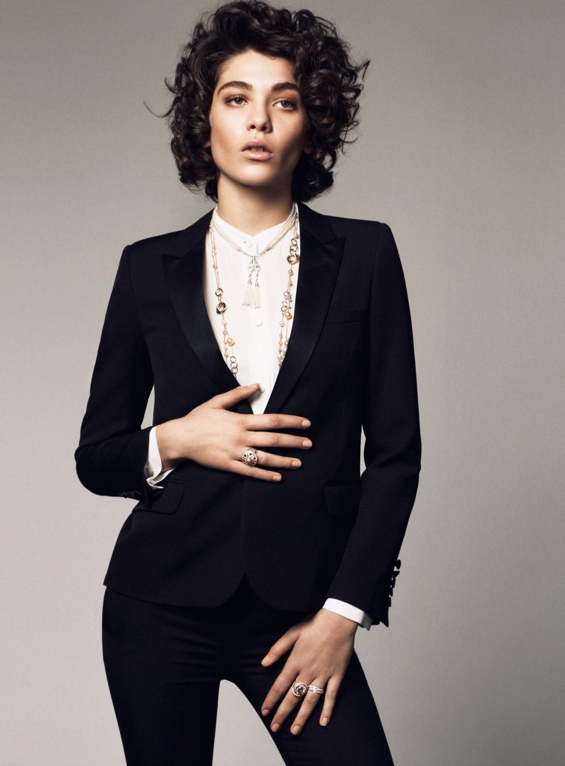 The curly haired beauty rocks a menswear inspired tuxedo jacket