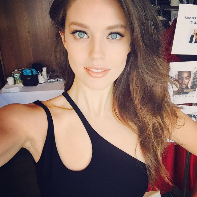 Emily DiDonato shows off a major beauty look on set of Maybelline. Photo via Instagram.