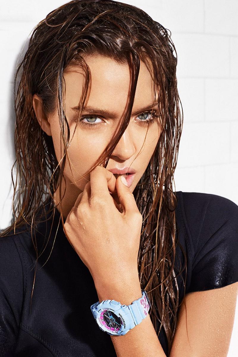 Josephine wears a sleek and wet hairstyle