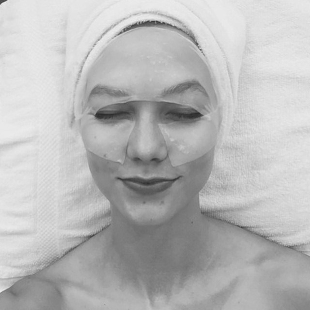 Karlie gets a face mask before the big event
