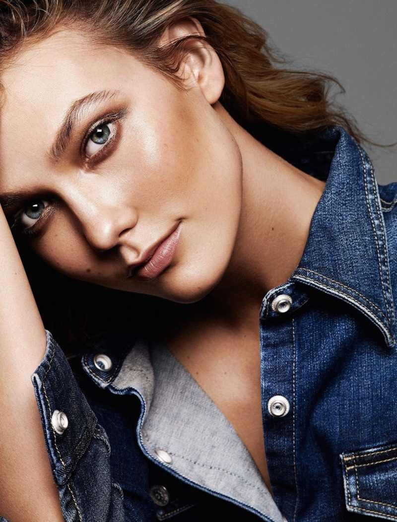 Karlie wears a denim jacket in the feature
