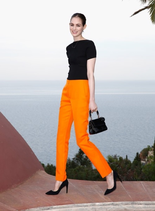 Laura Love in a Dior black wool top and wool pants. Photo: Getty Images