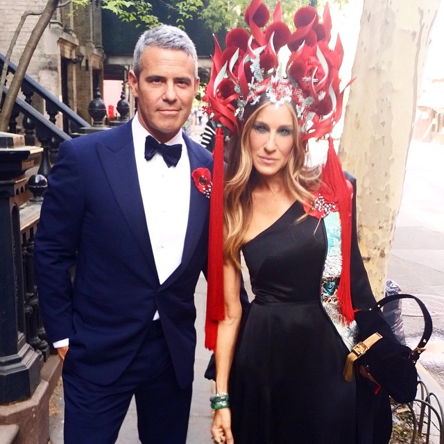 Sarah Jessica Parker wears an interesting headpiece while posing with Bravo's Andy Cohen