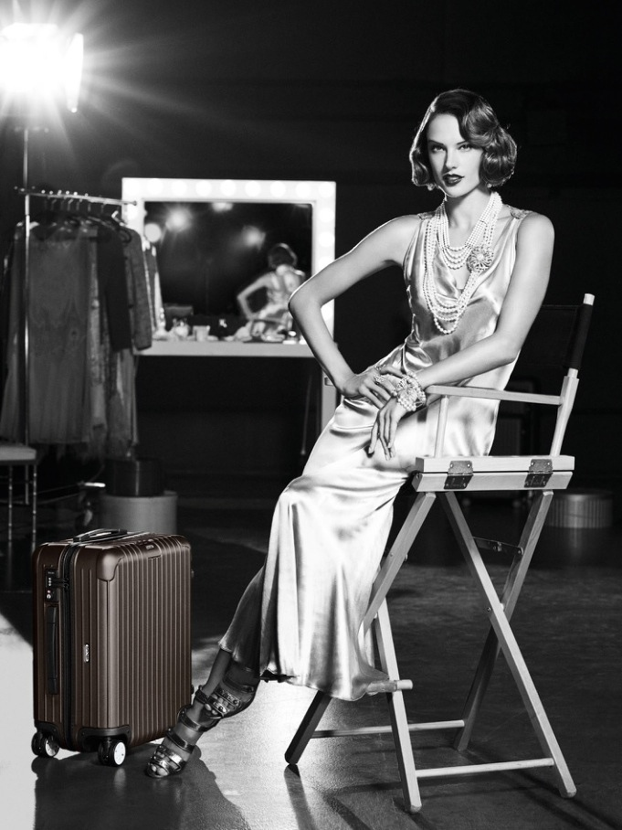 Alessandra Ambrosio channels flapper style in 2015 Rimowa Luggage campaign.