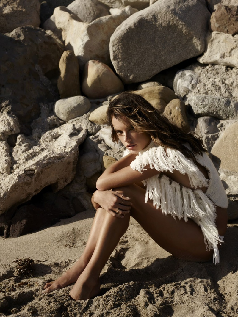 Alessandra takes on a fringed top in white
