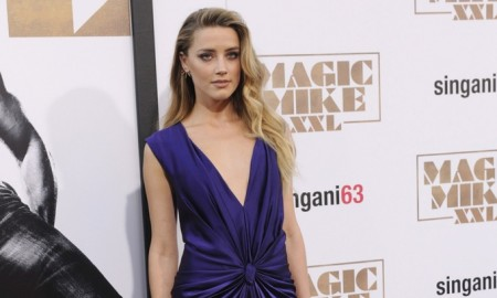 Amber Heard was pretty in purple, wearing a v-neck silk dress designed by Monique Lhuillier. Photo: Tinseltown / Shutterstock.com