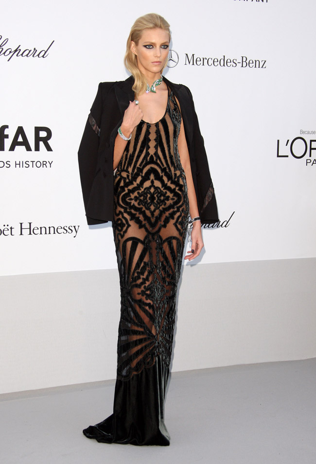 Model Anja Rubik showed off svelte physique in a black, sheer Emilio Pucci gown designed by Peter Dundas. Talk about going nearly naked! Photo: Featureflash / Shutterstock.com