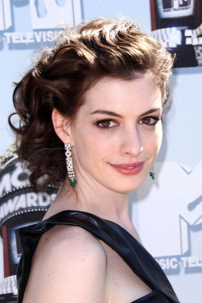 Anne Hathaway went for a romantic updo with Grecian inspired waves at the 2008 MTV Movie Awards. Photo: s_buckley / Shutterstock.com