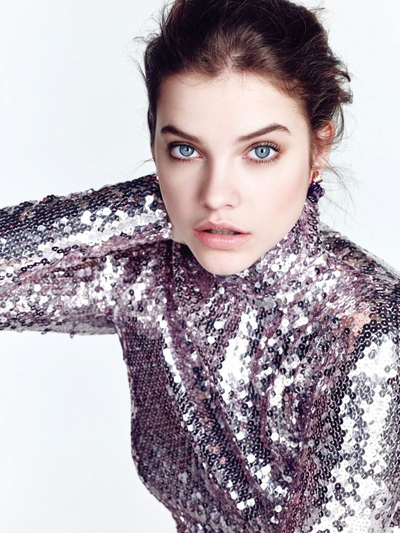 The Hungarian model wears a sequin embellished Dior top