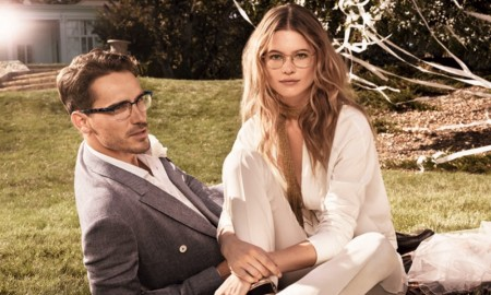 Behati models a 70s style pantsuit look in white