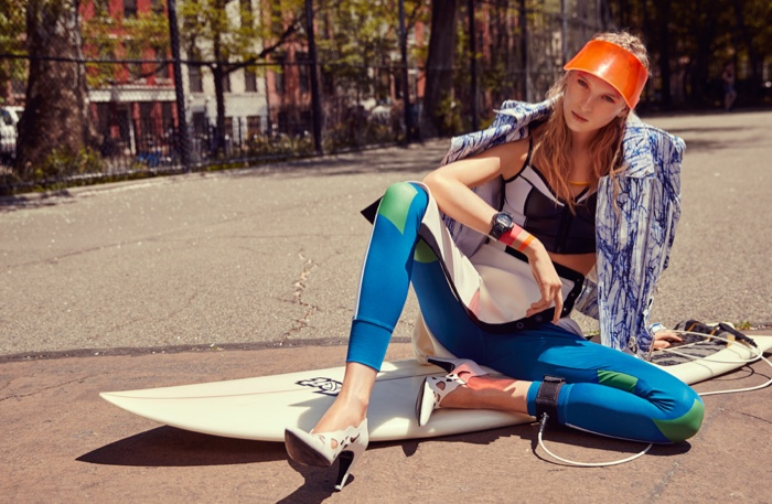 Color blocking is key to the blonde's surfer chic looks including a visor, heels and a bra top