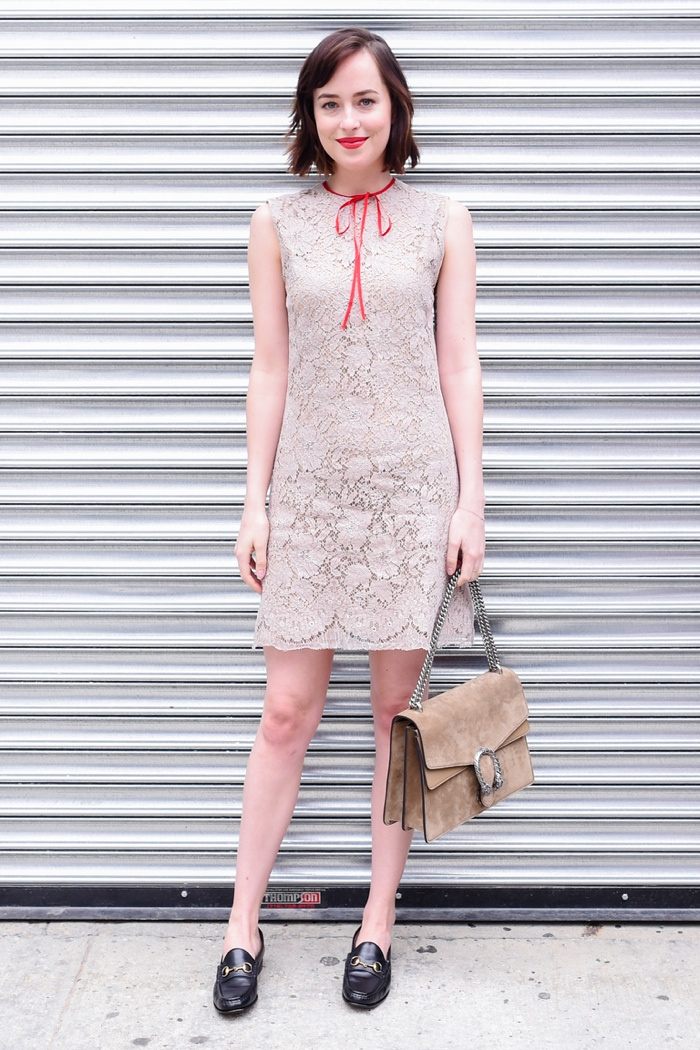 Dakota Johnson wears lace Gucci dress at the label's resort 2016 show. Photo: BFA/Gucci
