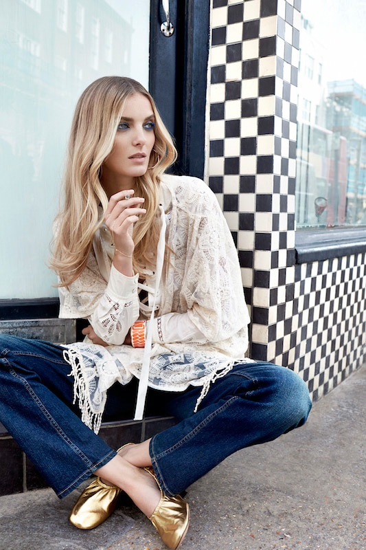 Denisa gets bohemian with a fringed white blouse and denim pants