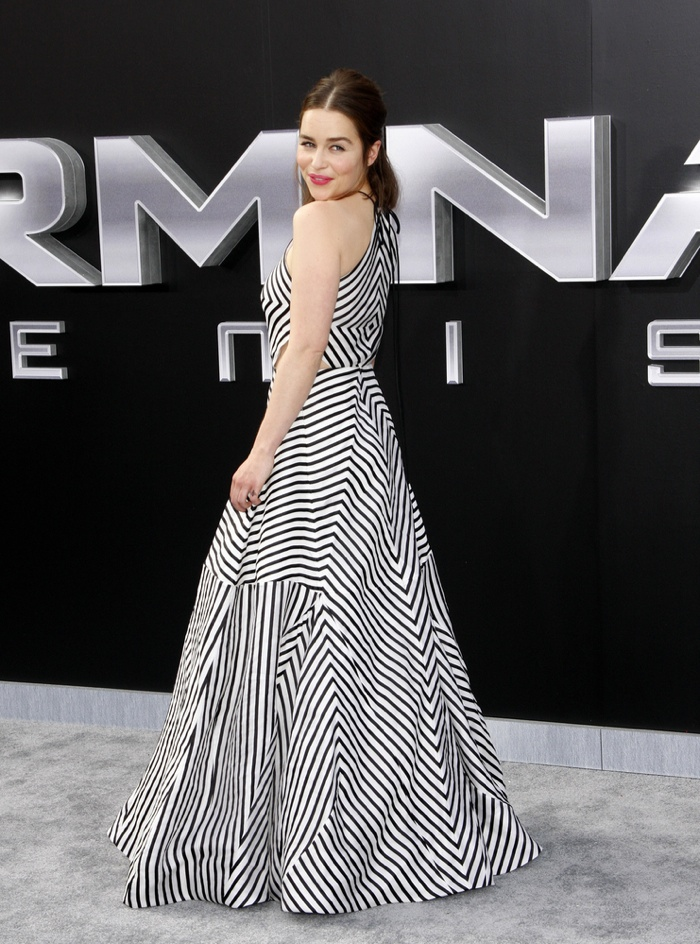 Emilia Clarke wears striped Rosie Assoulin dress. Photo: Tinseltown / Shutterstock.com