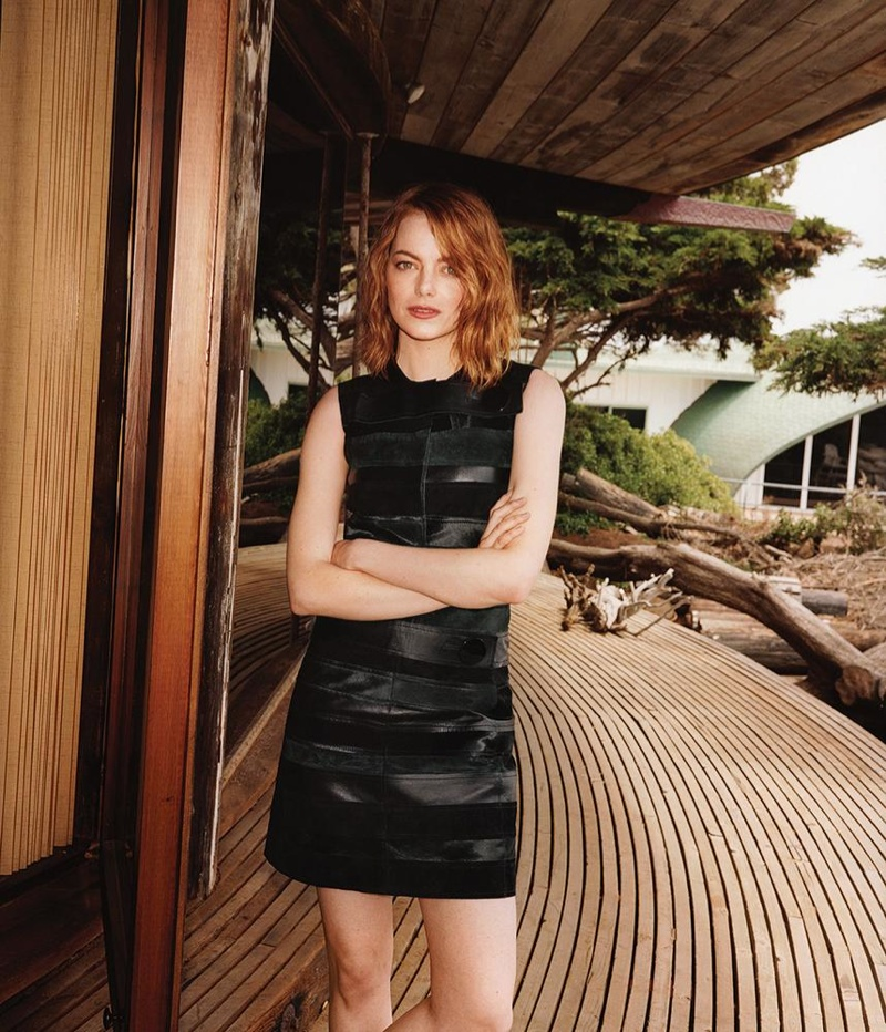 Emma wears a Calvin Klein Collection leather dress