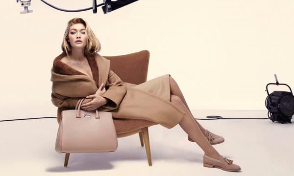 Gigi wears an oversized coat from Max Mara