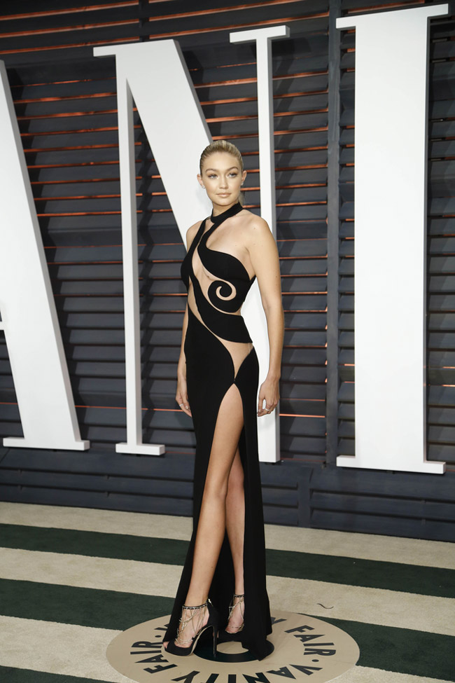 Gigi Hadid was another model who was not afraid to bare almost all. At the Vanity Fair Oscar Party, the Sports Illustrated model sported an Atelier Versace gown with sheer paneling. Photo: Helga Esteb / Shutterstock.com