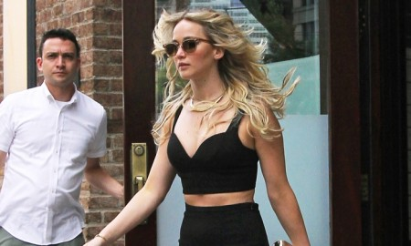 Jennifer Lawrence wears Michael Kors crop top and skirt while out and about in New York on June 29, 2015. Photo: Splash News
